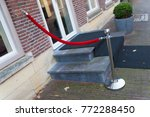 single red rope barrier at the... | Shutterstock . vector #772288450