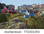 colorful houses on rocky hill ... | Shutterstock . vector #772331353