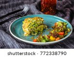 zucchini pancakes with salad at ... | Shutterstock . vector #772338790
