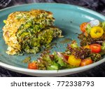 zucchini pancakes with salad at ... | Shutterstock . vector #772338793