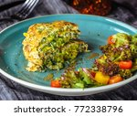 zucchini pancakes with salad at ... | Shutterstock . vector #772338796