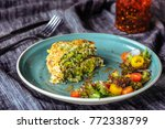 zucchini pancakes with salad at ... | Shutterstock . vector #772338799