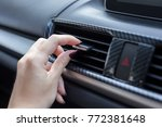 Small photo of hand sliding way of car Air flow of air conditioner switch in automobile