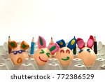 close up 4 eggs happy and... | Shutterstock . vector #772386529