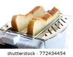 toast in a toaster. fried toast ... | Shutterstock . vector #772434454