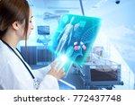 female doctor operating... | Shutterstock . vector #772437748