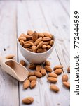 almonds on wood table   Shutterstock . vector #772444969
