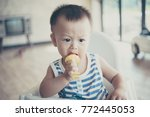asian cute baby boy are eating... | Shutterstock . vector #772445053