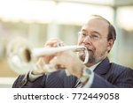 Small photo of professional musician performs a musical composition on the pipe