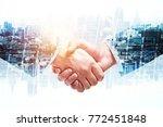 creative handshake on abstract... | Shutterstock . vector #772451848