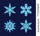 Collection of glowing neon snowflakes in line style isolated on dark background - stock vector