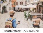 happy female girl tourist... | Shutterstock . vector #772461070