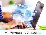 hands using laptop with... | Shutterstock . vector #772465180