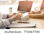 doctor pressing pressure blood... | Shutterstock . vector #772467730