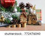 miniature wood house on rolls... | Shutterstock . vector #772476040