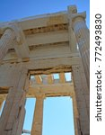 Small photo of The Propylae or monumental gateway with Ionic and Doric columns to the Athens Acropolis, Greece