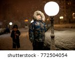 children play winter in park... | Shutterstock . vector #772504054