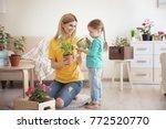 cute little girl with mother... | Shutterstock . vector #772520770