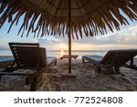 sun loungers with umbrella on... | Shutterstock . vector #772524808