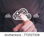 businessman presses button... | Shutterstock . vector #772527328