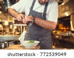 working young cook close up | Shutterstock . vector #772539049