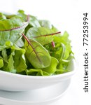 A bowl of mixed lettuce. Shallow depth of field, selective focus - stock photo
