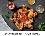 fried chicken wings with sauce... | Shutterstock . vector #772540963