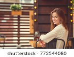 smiling woman in cafe | Shutterstock . vector #772544080