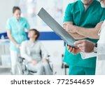 confident professional doctors... | Shutterstock . vector #772544659