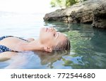 beautiful middle age tourist... | Shutterstock . vector #772544680