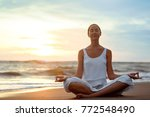 young girl practicing yoga on... | Shutterstock . vector #772548490
