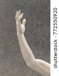 arm sculpture on gray... | Shutterstock . vector #772550920