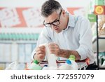 shocked man doing grocery... | Shutterstock . vector #772557079