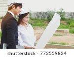 team engineers surveying land... | Shutterstock . vector #772559824