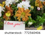 bouquet of flowers with a note... | Shutterstock . vector #772560406