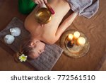 young woman having massage... | Shutterstock . vector #772561510