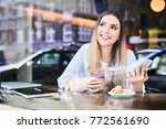 beauitful smiling woman using... | Shutterstock . vector #772561690