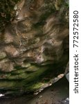 Small photo of Alluviation deposits in a cave with selective focus