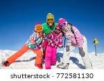 happy family in alpin ski... | Shutterstock . vector #772581130