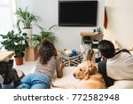 teens watching tv and lying on... | Shutterstock . vector #772582948