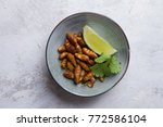 fried insects  wood worm insect ...   Shutterstock . vector #772586104