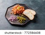 salmon tartare with yolk ...   Shutterstock . vector #772586608