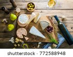 cheese on wood. types of cheese ... | Shutterstock . vector #772588948