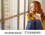 pretty redhead woman savoring... | Shutterstock . vector #772598590