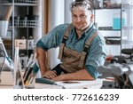 Happy craftsman after completing a big project for a woodwork company - stock photo