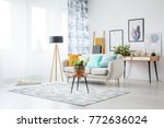 stool with plant on carpet and... | Shutterstock . vector #772636024