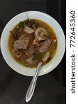Small photo of Hot and Spicy beef offal Soup with herbs Thai style in the white bowl, -Top view, Bangkok Thailand