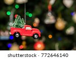 red pickup car with christmas... | Shutterstock . vector #772646140