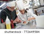 professional cook chefs in... | Shutterstock . vector #772649584