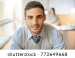portrait of young businessman... | Shutterstock . vector #772649668